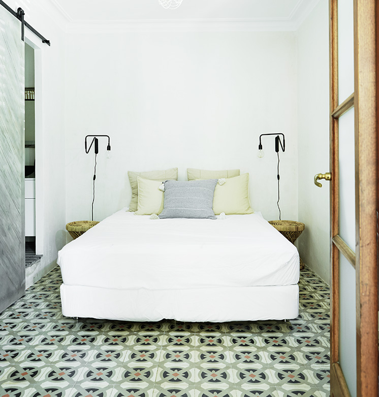 wall to wall cement tile floor guest bedroom