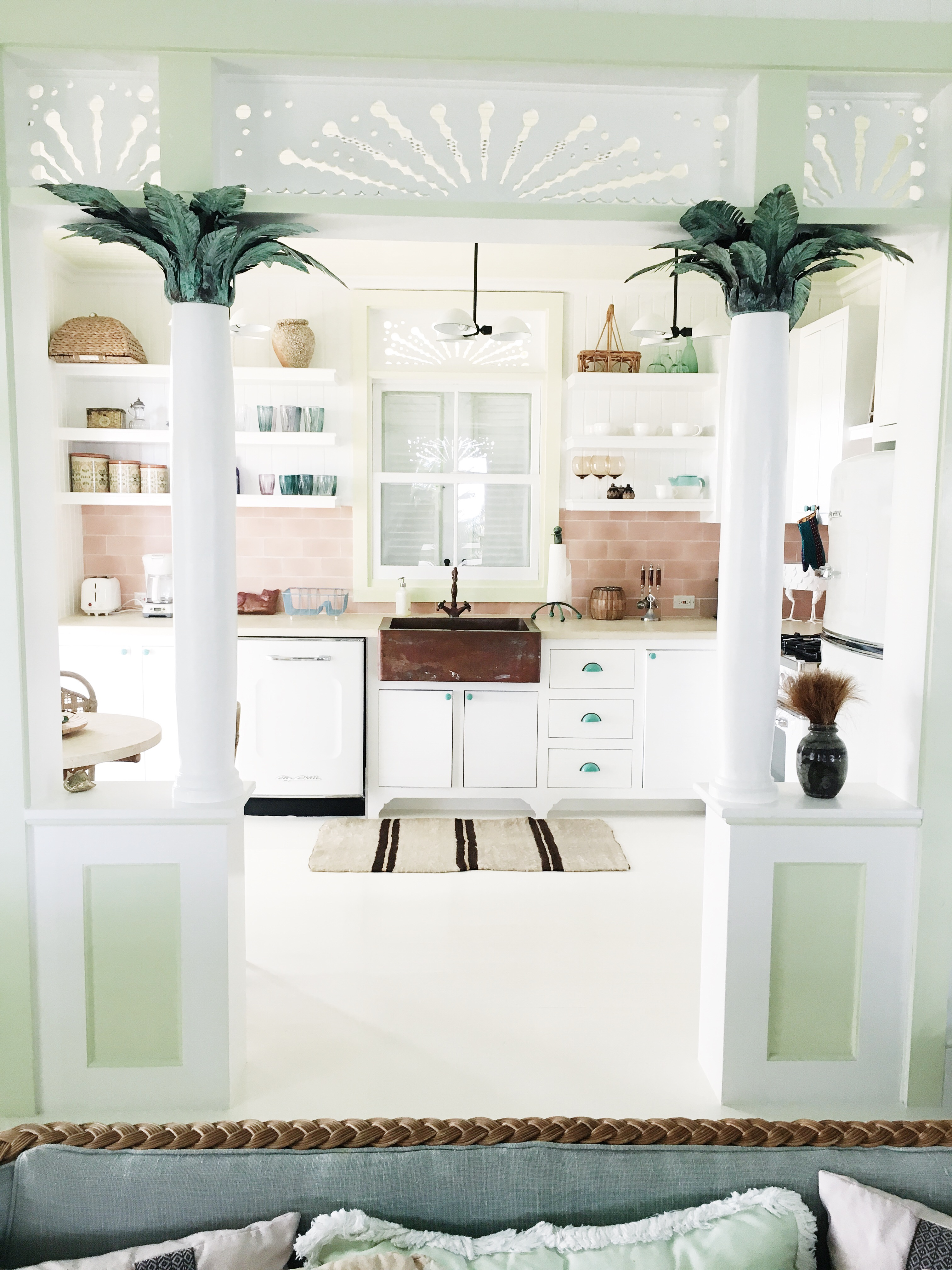 retro kitchen island decor columns copper palm leaf tops