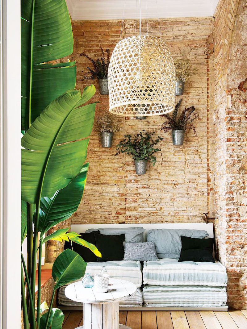 bright barcelona apartment tour sitting room chandelier cushion couch