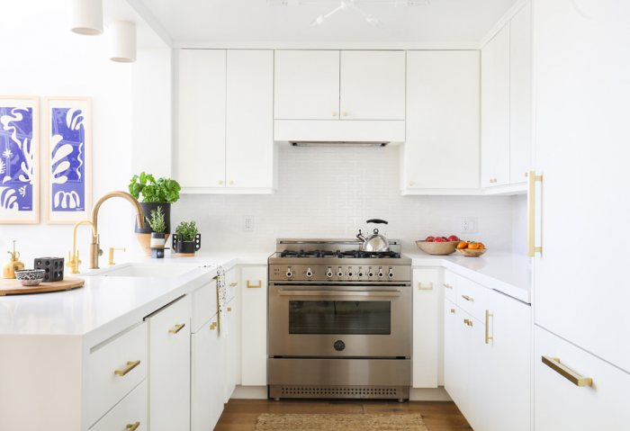 Bright white kitchen gold brass faucet cabinet pulls