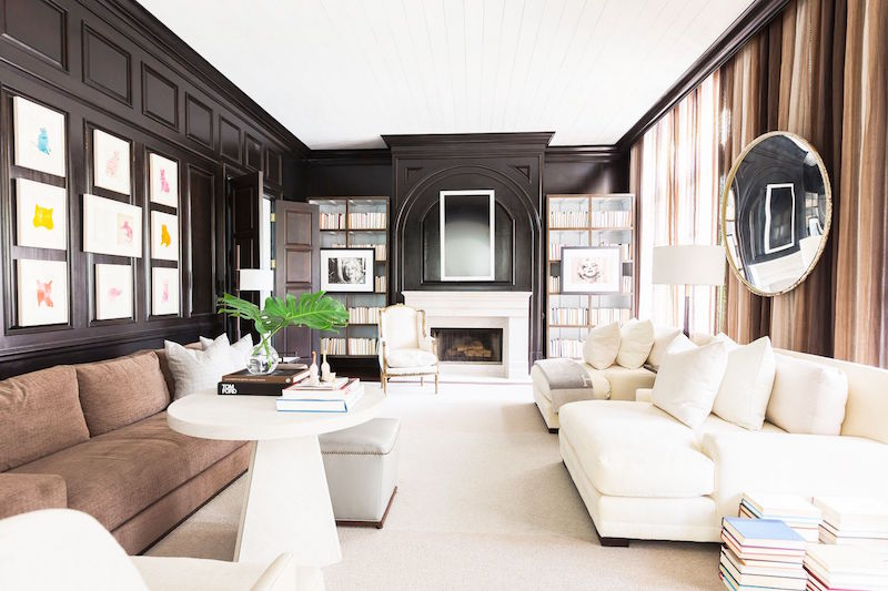 built in bookshelves black walls cream furniture
