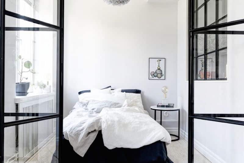 Compact Quarters Master Bedroom White Bedding Steel Windows