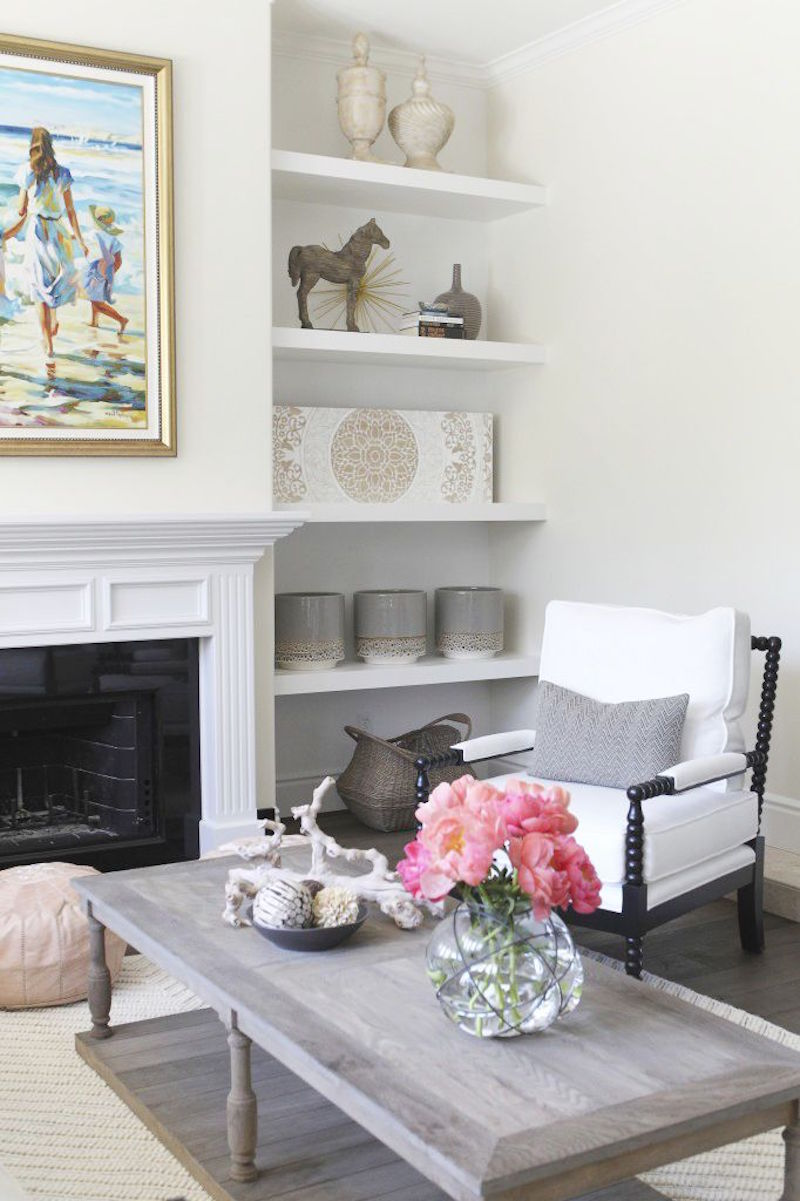 becki owens built in bookshelves pink peonies white fireplace mantel