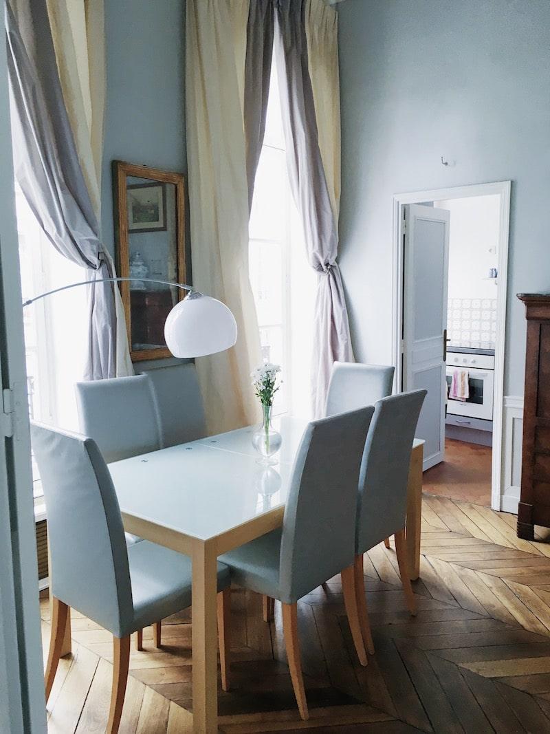 Paris dining room chevron floors table chairs lamp drapery