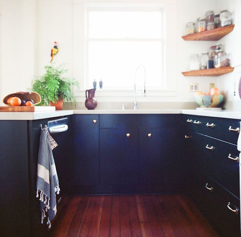 u shape kitchen navy cabinets wood floors