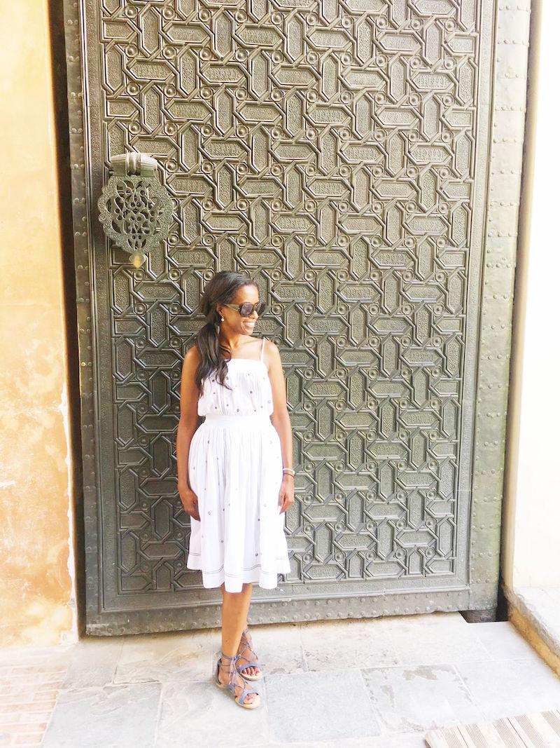 alcazar de sevilla iron wall white dress