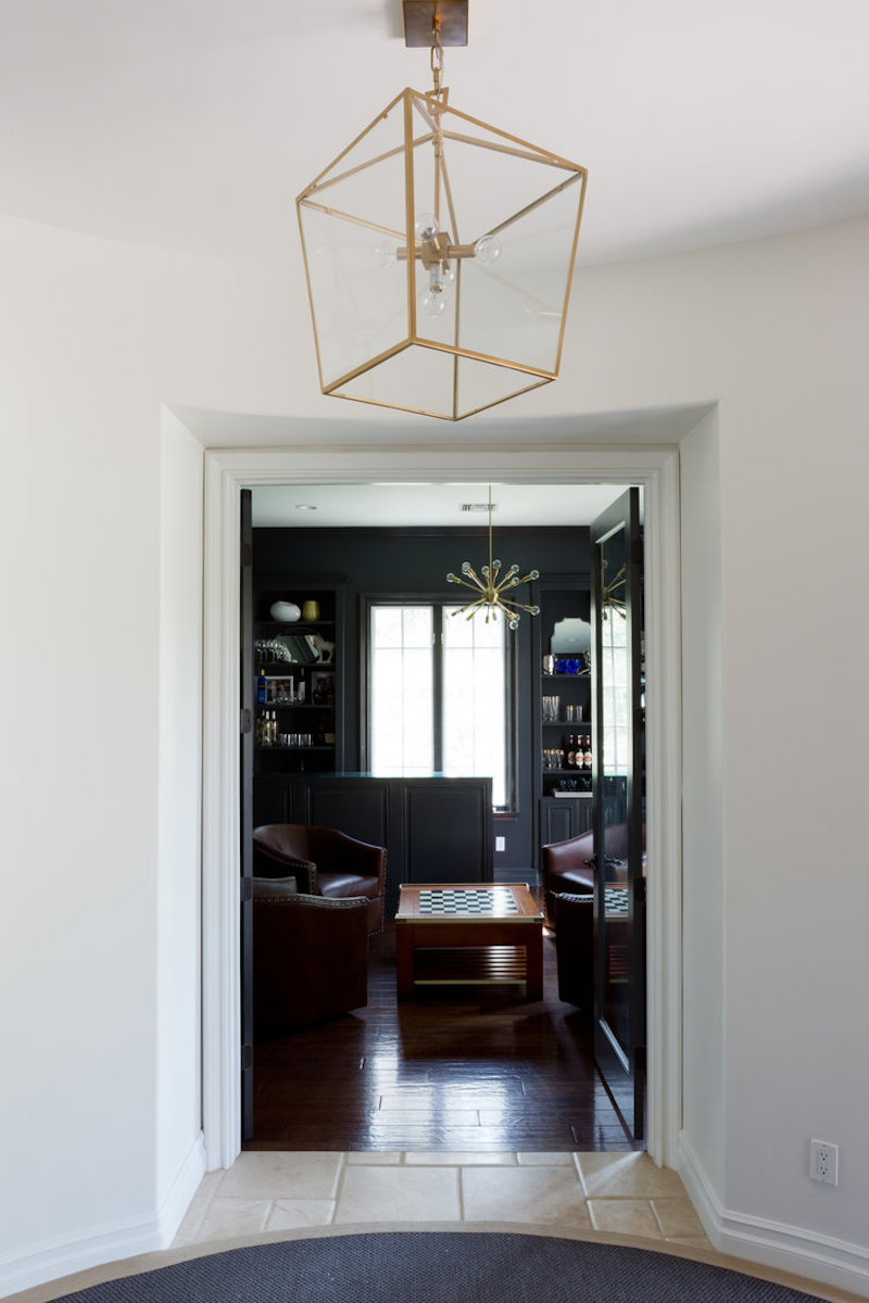 california home remodel library after gold light fixture dark grey walls