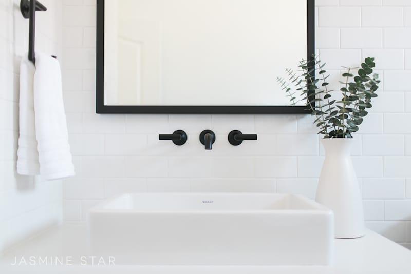 white sink black faucet