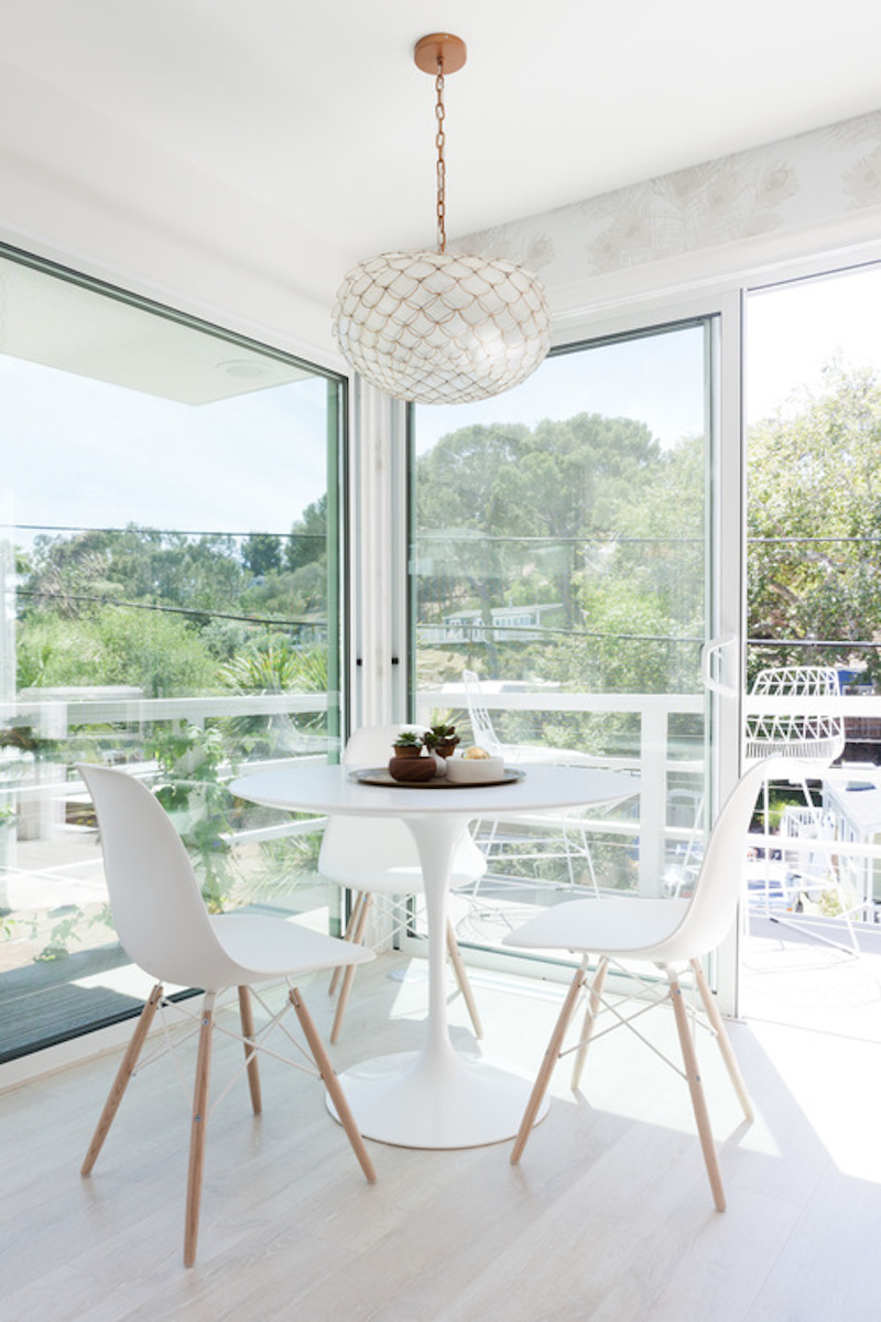 small white kitchen nook windows eames chair