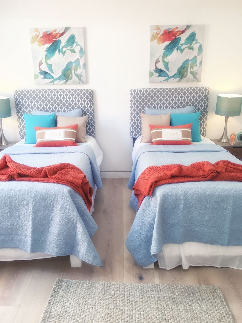 two-twin-bedrooms-blue-red-blanket-rug-art