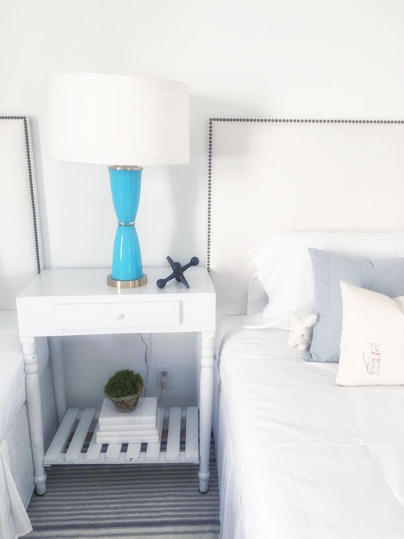 two-twin-bedrooms-cream-blue-bed-nightstand