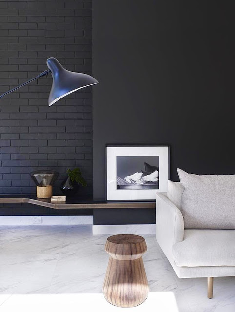 Living room with black walls and white tile floor