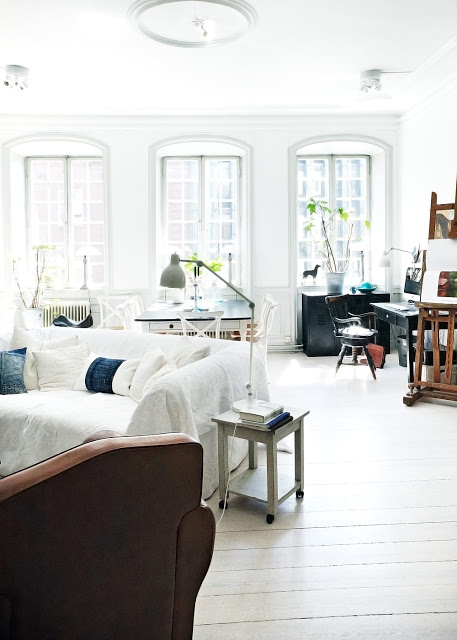 Beautiful apartment white living room with large windows