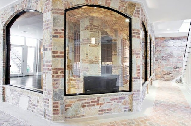 wine cellar with brick walls and brick herringbone floor