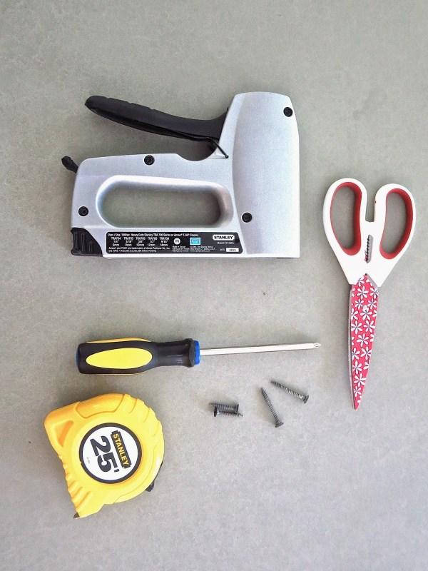 tools staple gun scissors screw driver measuring tape