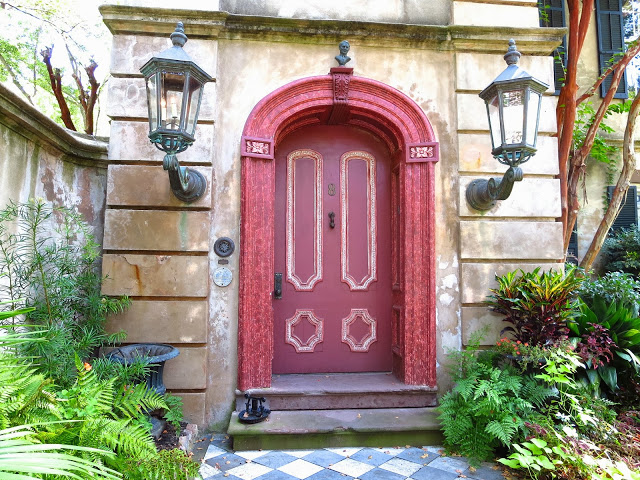 Arched red door and checkered marble path in Charleston, South Carolina