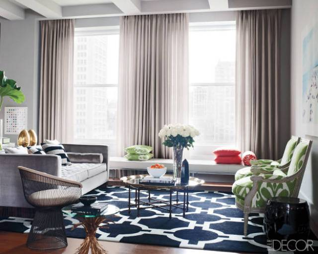 Living room with a Platner chair and navy graphic print rug