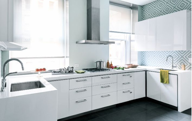small white kitchen light blue wallpaper geometric pattern stainless hood integrated cooktop cook bright