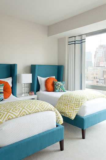 Luxury Clean and modern twin bedroom with white walls and floor the turquoise upholstered beds have