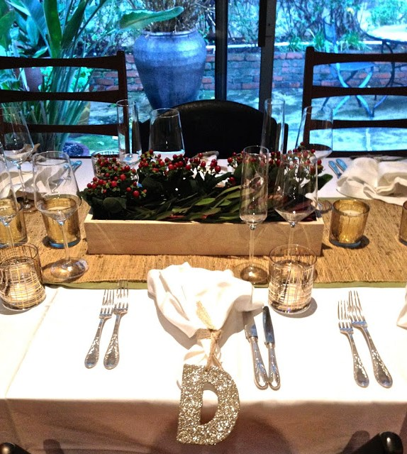 Holiday table setting with glitter ornament place cards and party favors