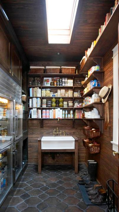 Pantry with Saltillo tile floors, wood paneled walls, open shelving, and a farm house sink