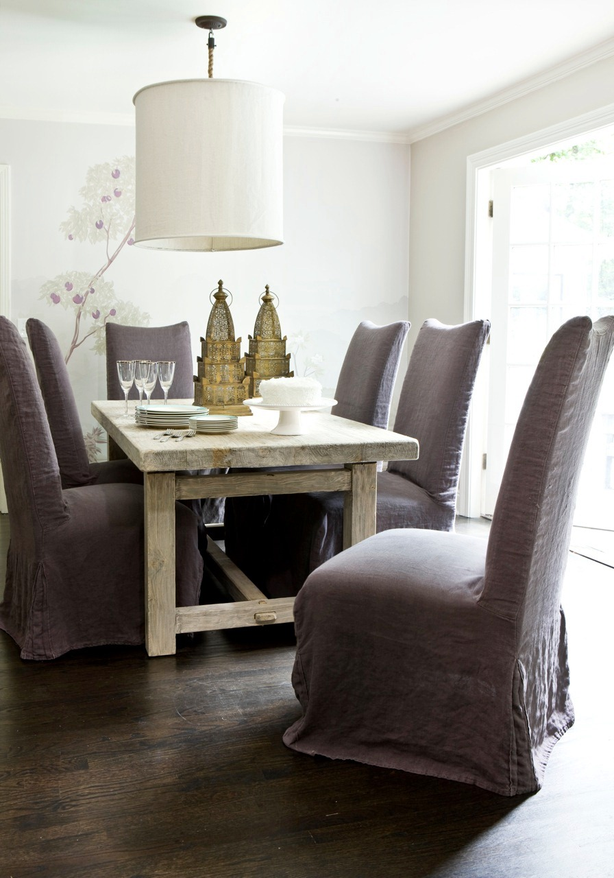 Spectacular The light wood rough hewn table the linen upholstered Parsons chairs the floral wallpaper and the large oversized drum chandelier all e together so