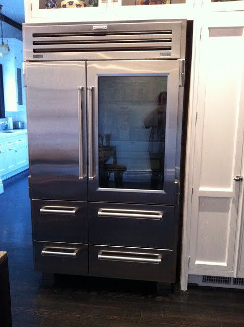 Close up of glass front Sub Zero refrigerator in a kitchen