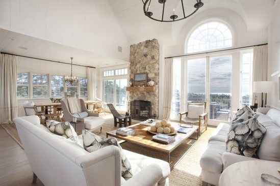 Living Room With French Doors, Neutral Sofas And Matching Armchair With Sea  Shell Print Accent