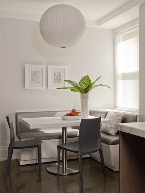 amie weitzman's gray breakfast nook with built in bench banquette style seating and two gray chairs