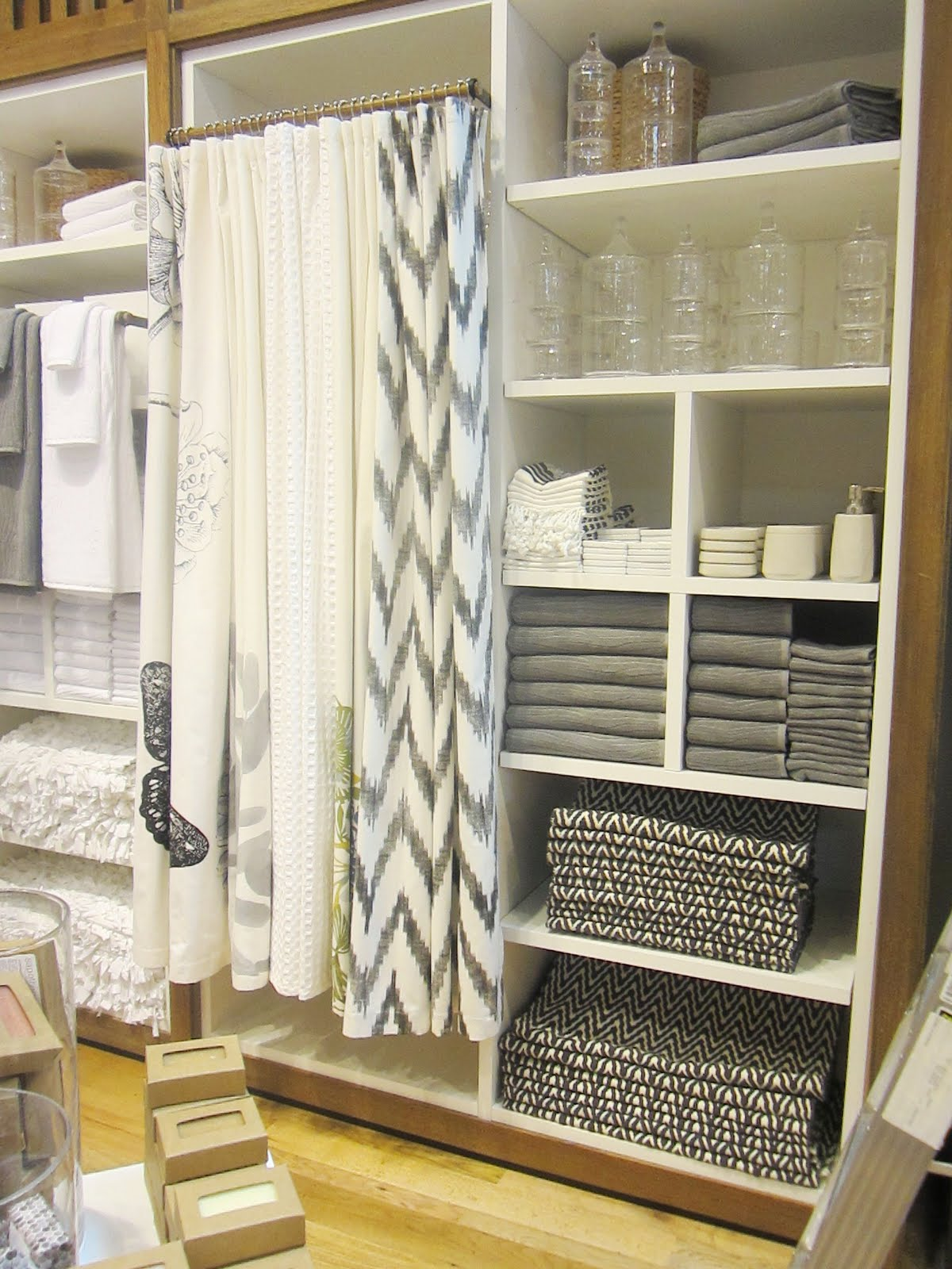 West elm bathroom accessories - White Cabinet Holding A Variety Of Black White And Grey Bath Accessories