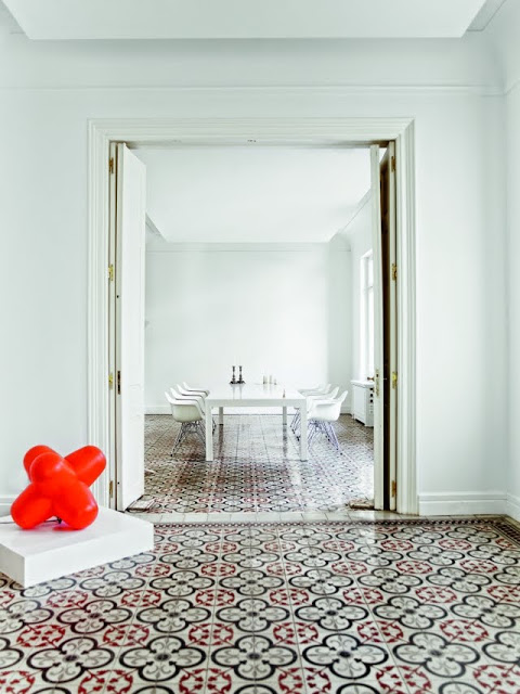 white dining room with Moroccan tiles
