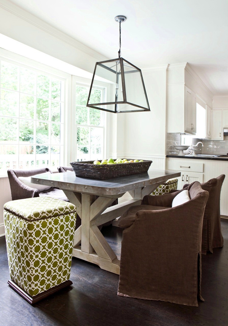 Stunning Breakfast nook with a trestle table metal top low back upholstered chairs green