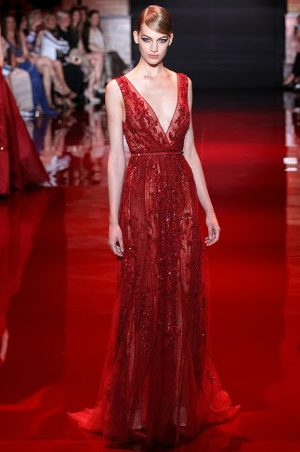 Model wearing a red Elie Saab haute couture dress