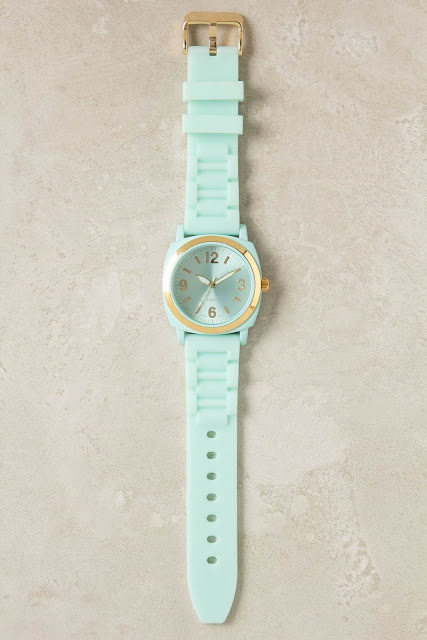 mint green watch with gold accents on the face