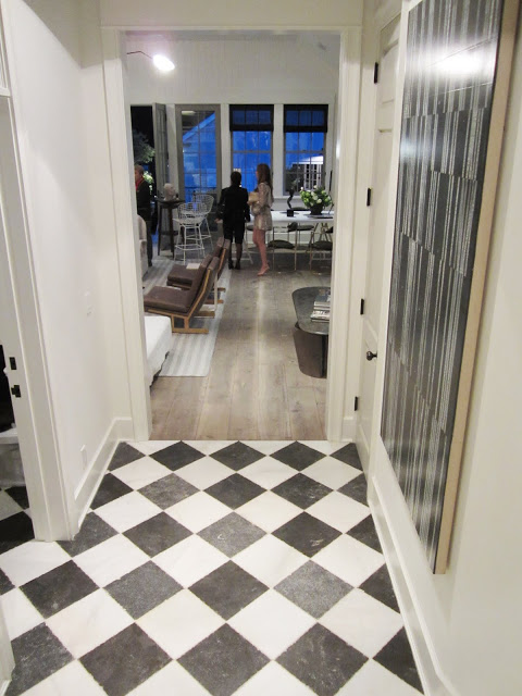 Hallway in the Windsor House with a black and white checkerboard marble floor