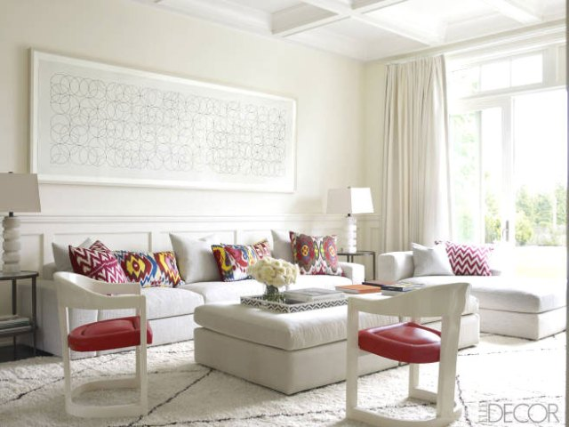 White living room with bright printed pillows