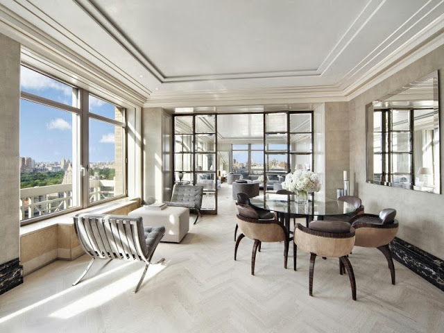 Informal dining room in a NYC penthouse with a view of central park, Barcelona chairs and modern furniture