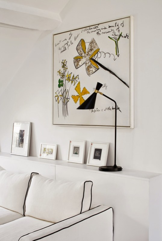 White Paris apartment with black and yellow accents