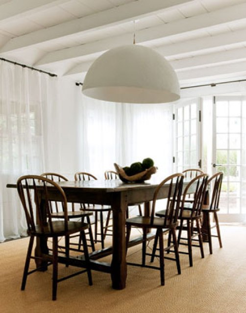 marie christine's cottage dining room with bentwood chairs, oversize dome pendant light, french doors, and white floor length curtains
