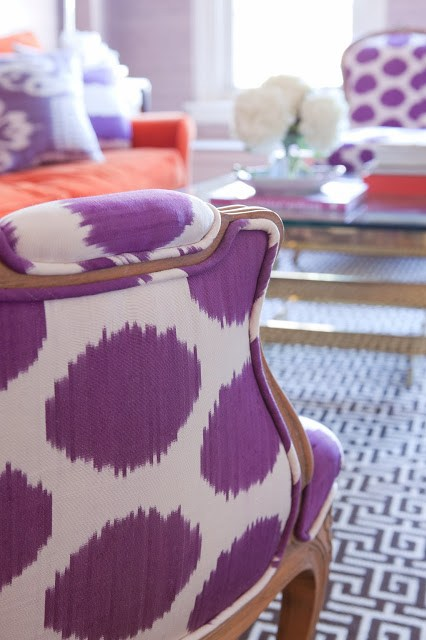 Close up of a purple and white armchair in a lavender living room
