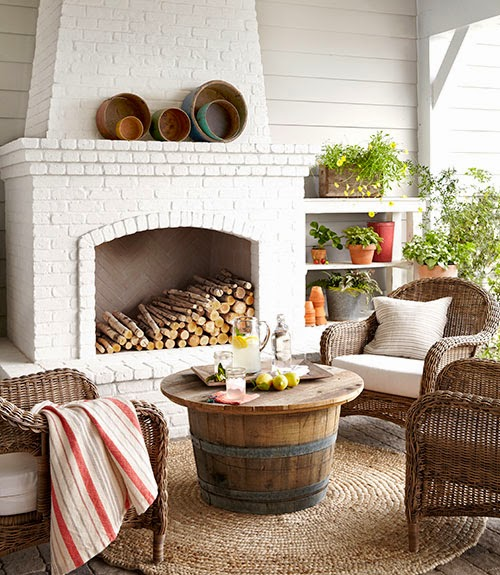 Outdoor Living Room With Wicker Chairs And Jute Rug