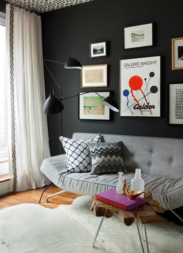 Home office by Jenny Wolf with Charcoal grey walls, wallpapered ceiling, modern furnishings, a gallery wall and a COCOCOZYpillow