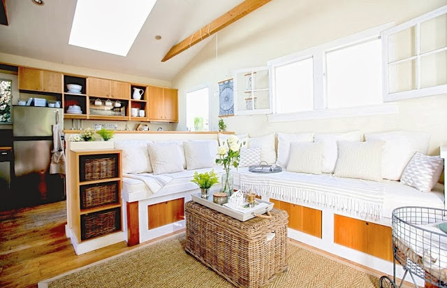 Built in L-shaped bench sofa acting as a room divider between the small living room and tiny kitchen