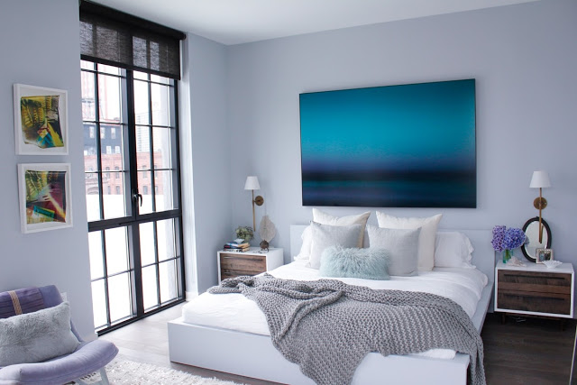 modern bedroom gray walls fade blue artwork art painting platform bed french doors