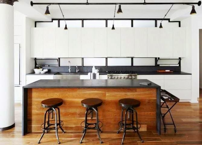 Contemporary Kitchen With Black Waterfall Island Counter