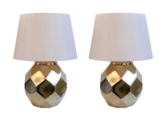 two ceramic lamps with white shades with brass finish