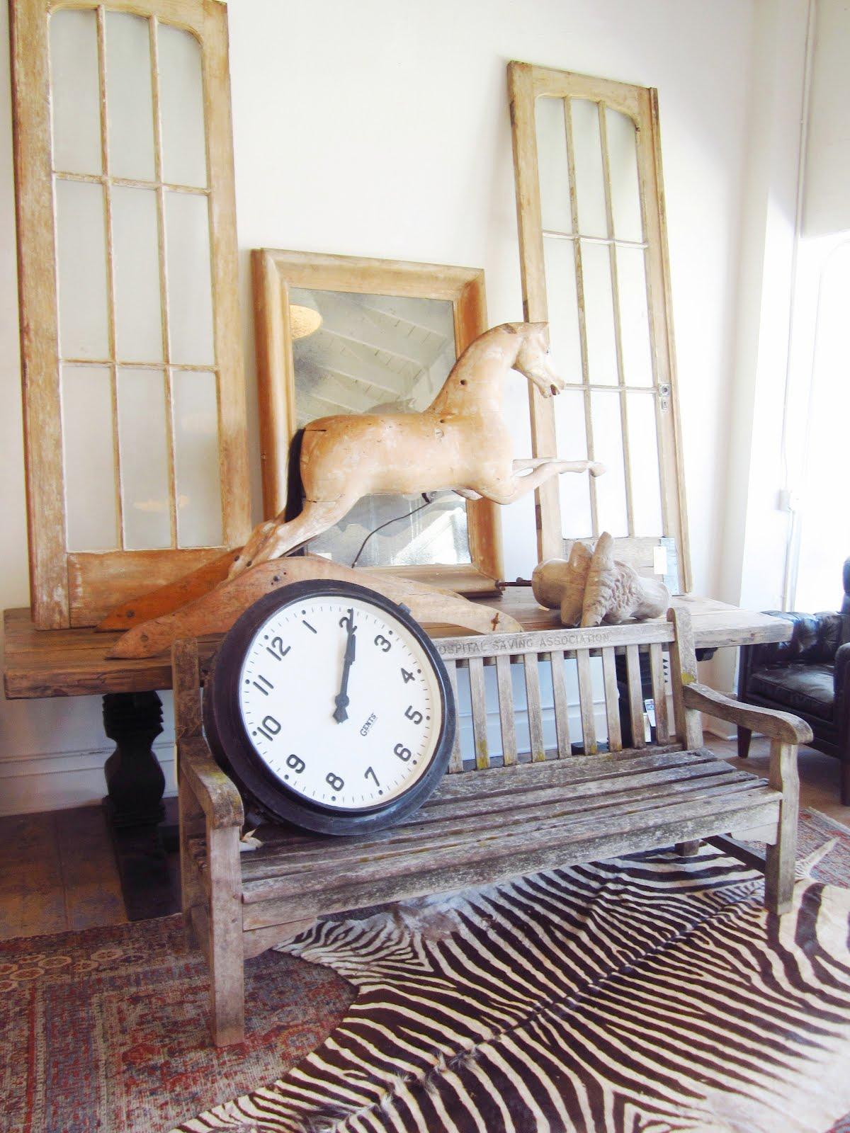 Brenda Antin Store In Los Angeles With A Reclaimed Wood Bench With A Large  Clock Sitting