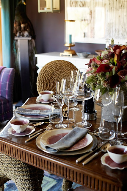 close up of the dining room table settings and wicker chairs