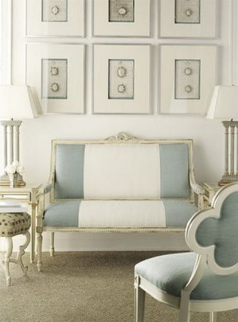 Modern classic living room with upholstered, blue and white striped Louis XIV bench and chair