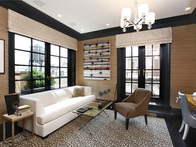 Living Room In An Apartment With Black Floors A Cheetah Print Rug Natural Grass